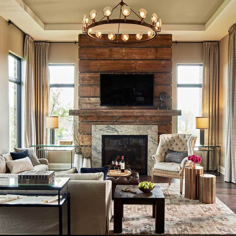 living room with round candle chandelier