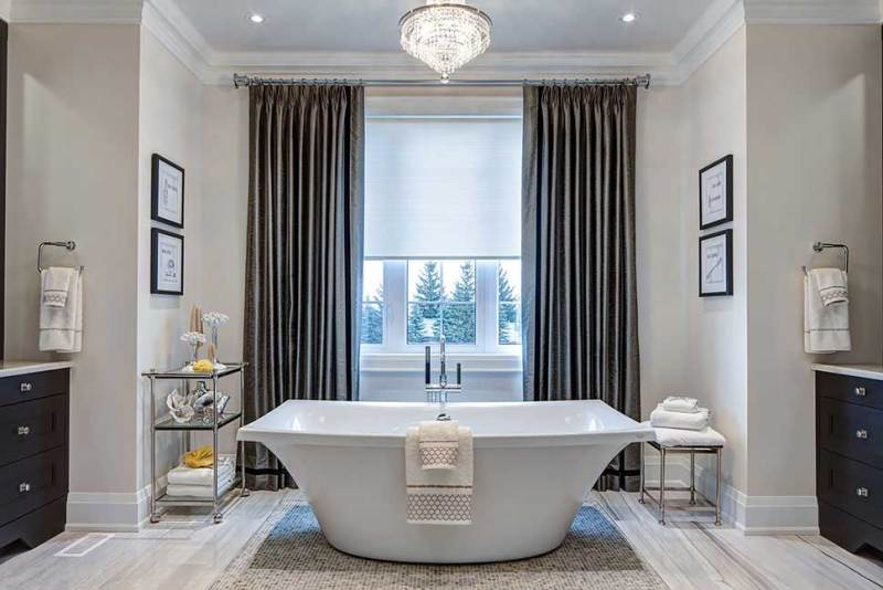 bathroom with chandelier and natural light