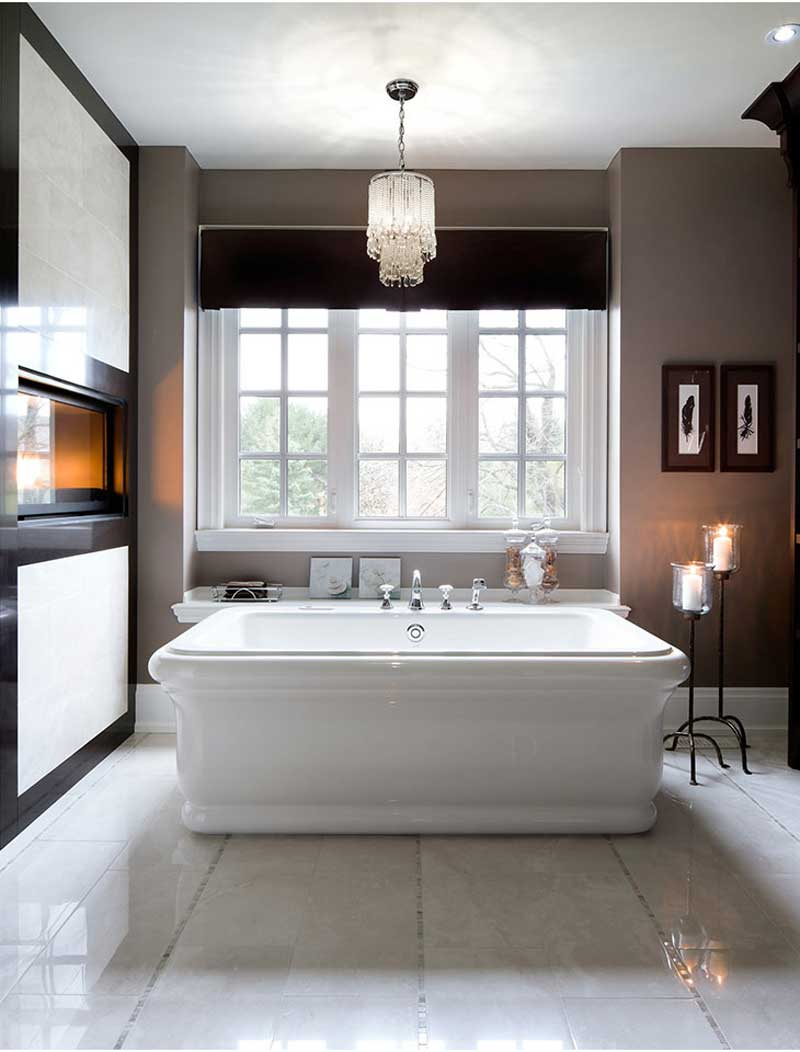 bathroom with chandelier and floor candle lamps