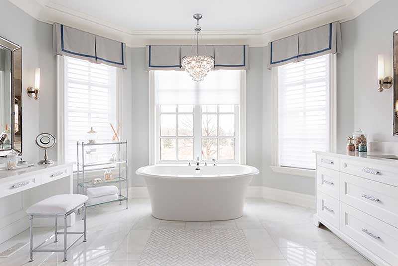 bathroom with natural lighting and crystal chandelier