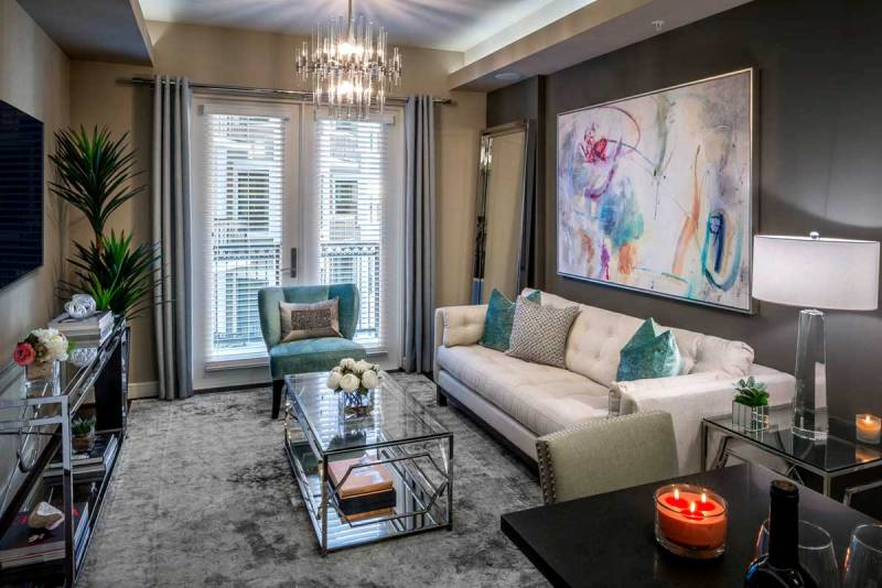 modern small living room with glass tube chandelier