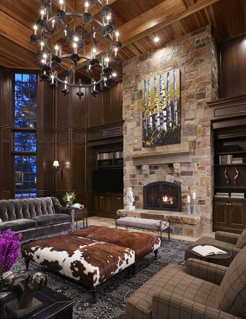 living room with 3 tier candle chandelier