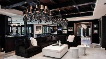 black living room with contemporary black chandelier lighting