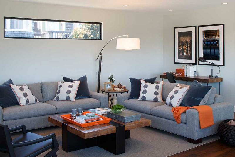 living room with drum shade arc floor lamp