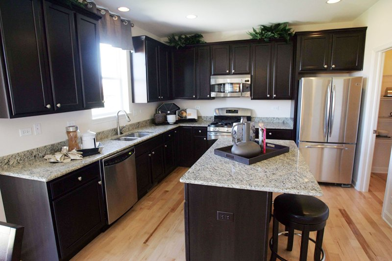 Santa ecilia granite countertops with black cabinets