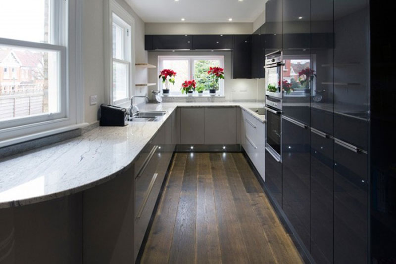 Ordinaire Galley Kitchen With River White Granite Countertops
