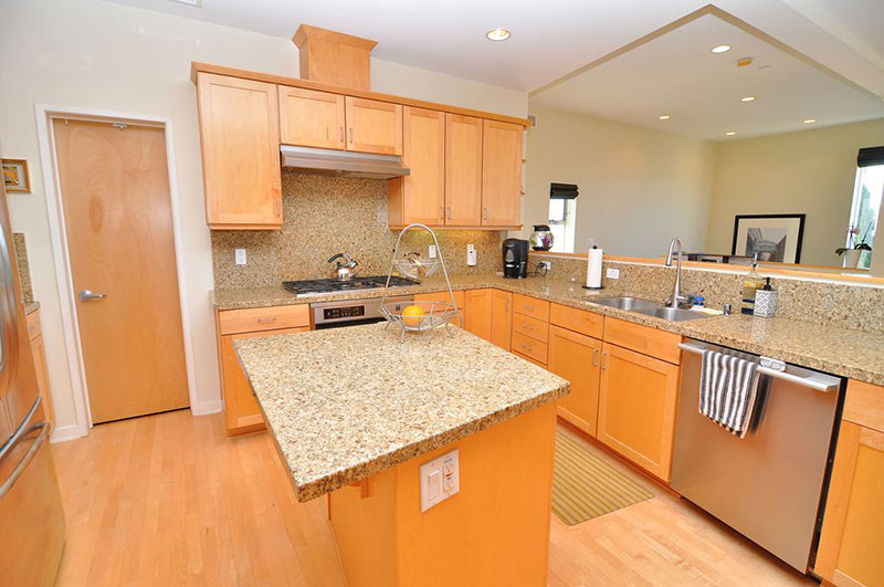 new venetian gold granite countertops with oak cabinets