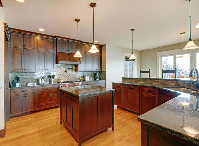 Tan brown granite countertops with dark cabinets