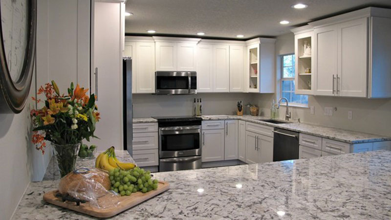White kitchen cabinets with white ice granite