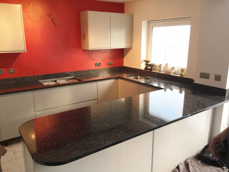 Small kitchen with with blue pearl granite