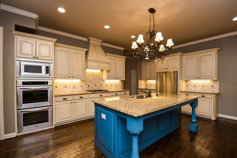 New Venetian Gold Granite With Antique White Cabinets