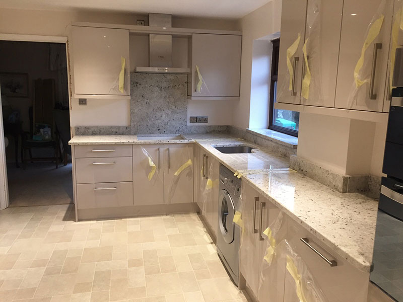 Modern Kitchen With Colonial White Granite Countertops