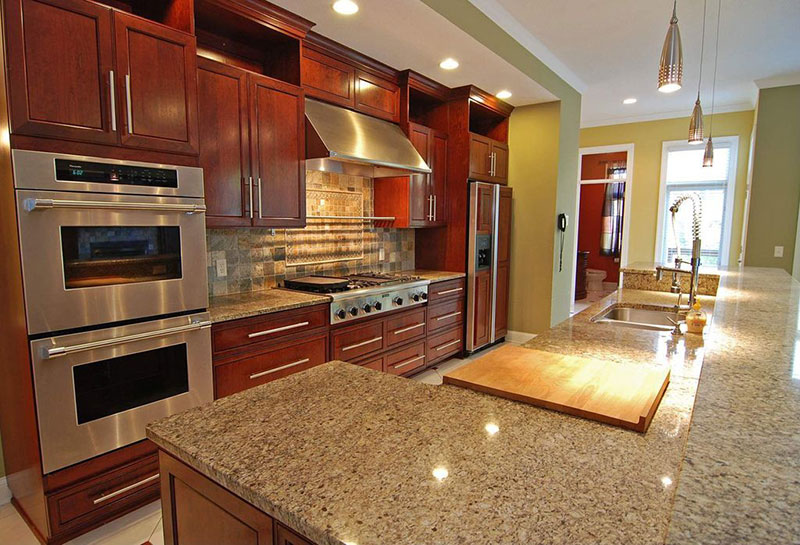 New venetian gold granite with cherry cabinets