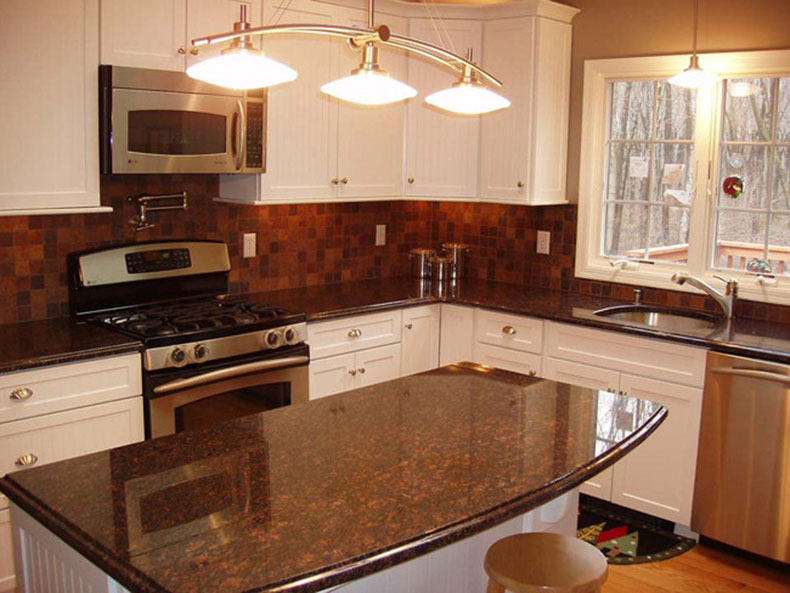 Tan brown granite countertops and backsplash