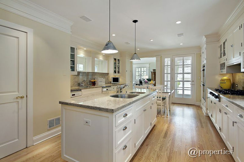 White kitchen with Kashmir white granite countertops