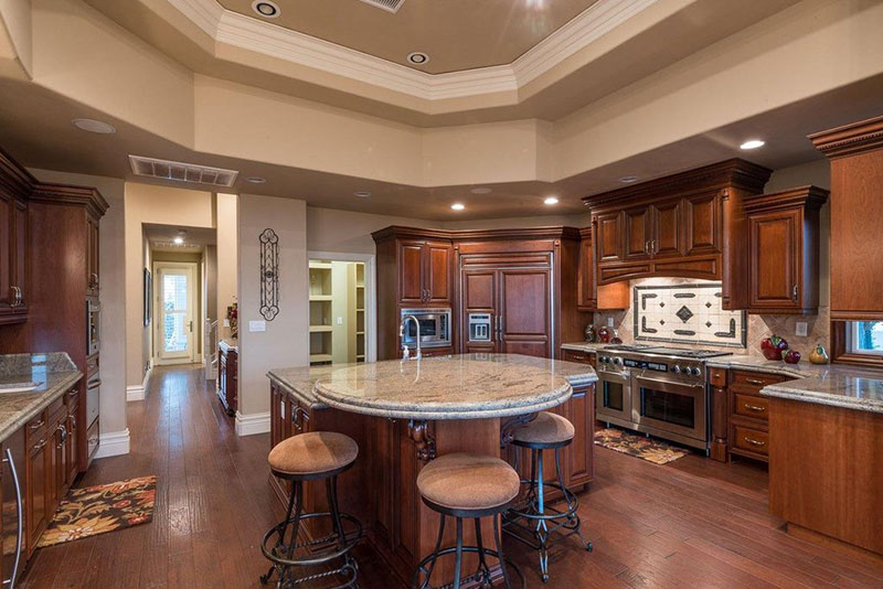Oak kitchen cabinets with colonial white granite
