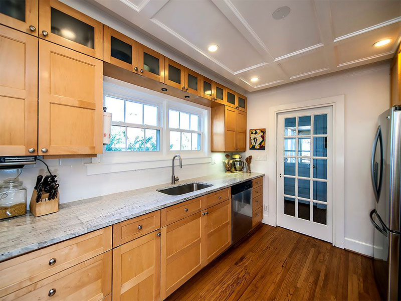 Maple cabinets with river white granite