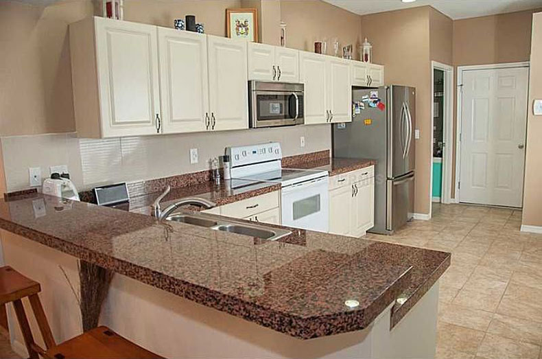 Superb Tan Brown Granite Countertops With White Cabinets