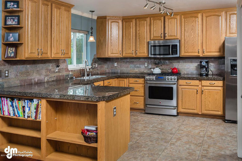 Craftsman kitchen with blue pearl countertops