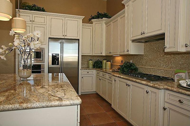 Giallo ornamental granite vs santa cecilia
