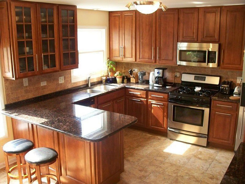 Tan brown granite countertops with wood cabinets