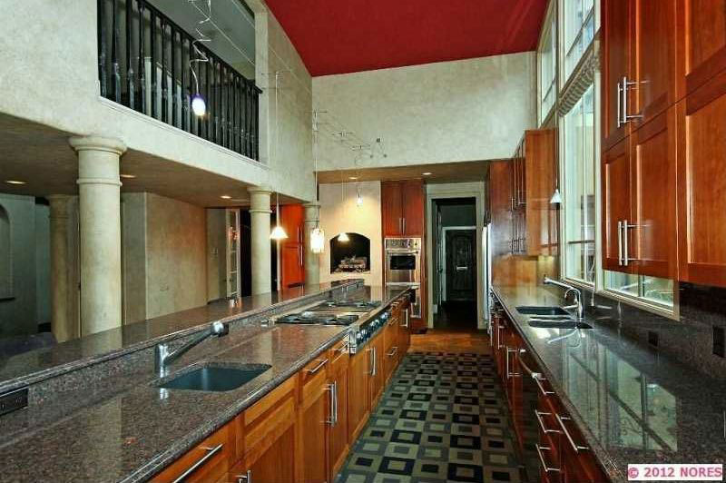 Galley kitchen with blue pearl granite