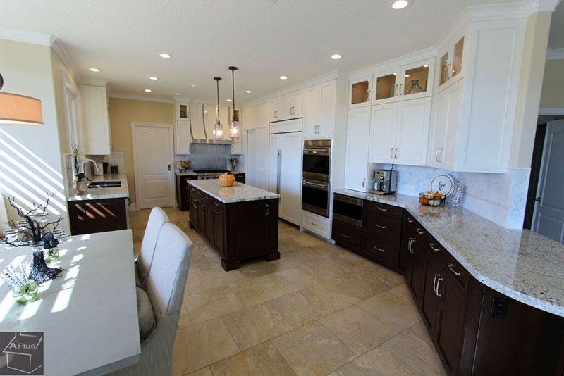 Dark Kitchen Cabinets With Colonial White Granite Countertops