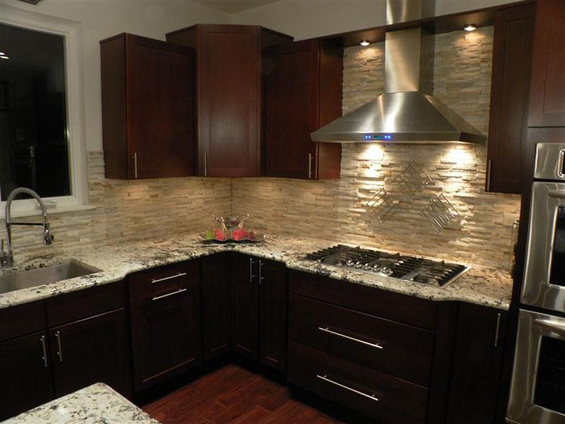 Bianco antico granite countertops with dark cabinets