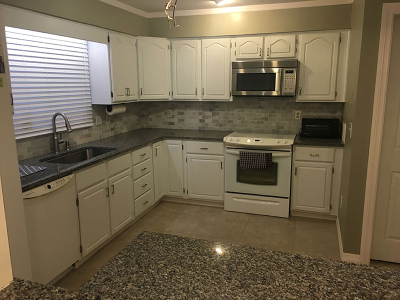 Small kitchen with new caledonia granite countertops