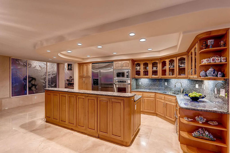 Contemporary kitchen with blue pearl countertops