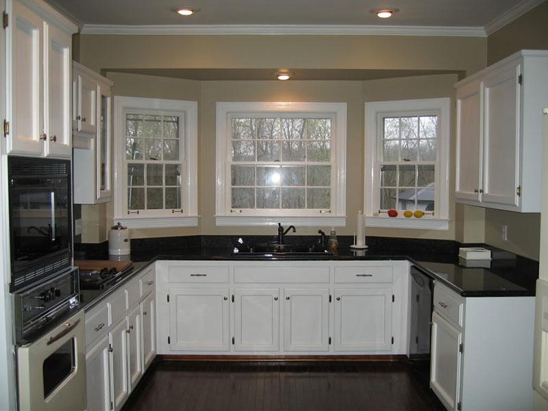 Small kitchen with uba tuba granite
