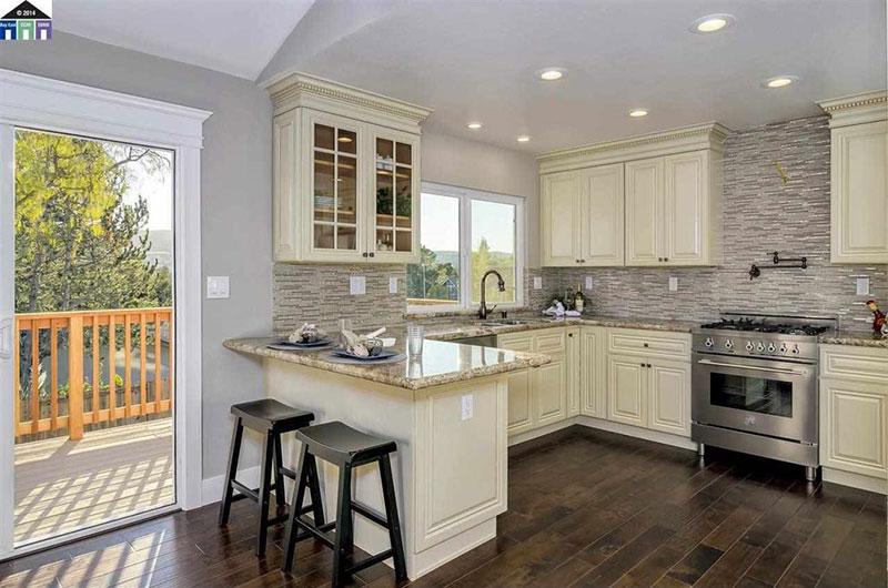 Giallo ornamental granite with cream cabinets