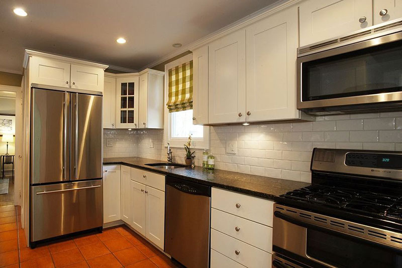 Traditional kitchen with black pearl granite countertops
