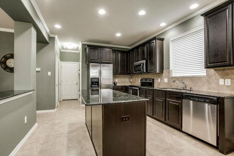 Black kitchen cabinets with black pearl granite countertops