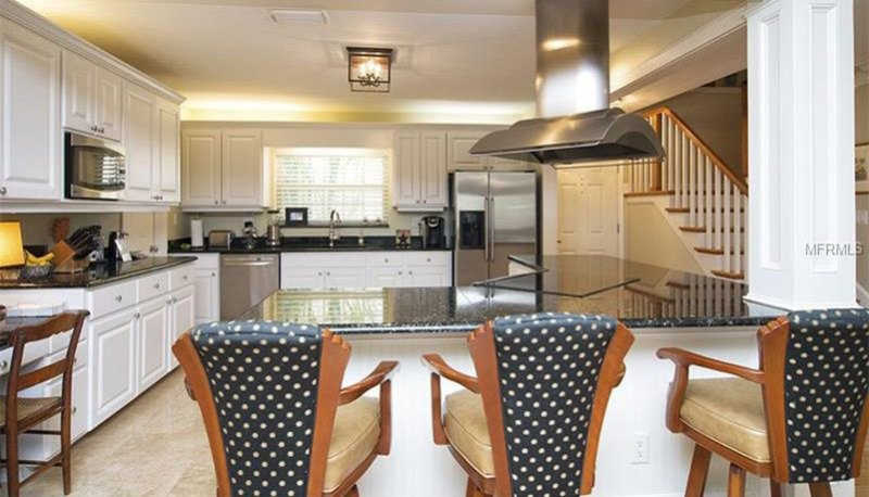 Black pearl countertops with white cabinets