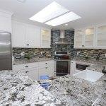 Alaska white granite with subway tile backsplash