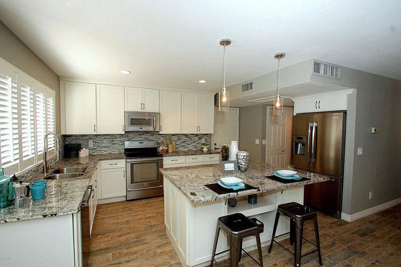 Contemporary Kitchen Design With Alaska White Granite Countertops