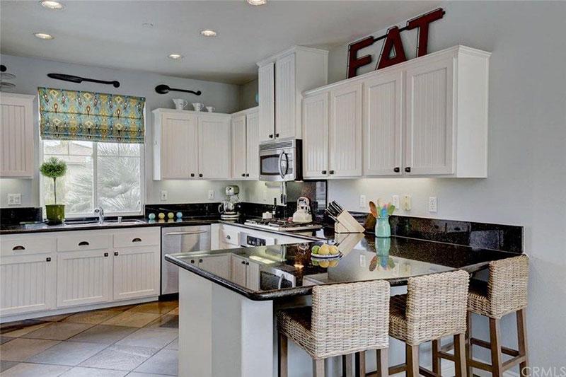 Black pearl granite countertops with white cabinets