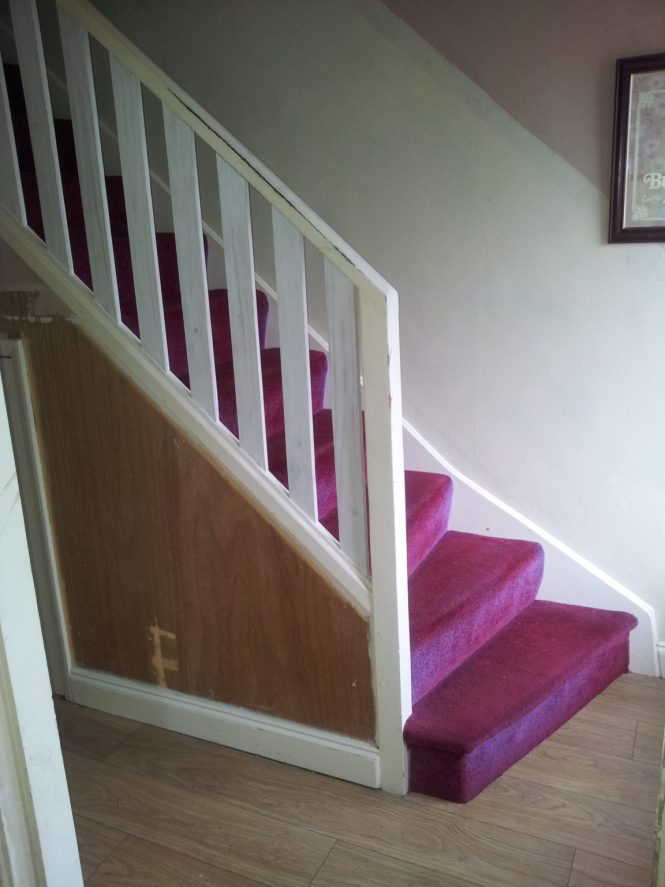 This is our staircase as we inherited it. Click on the picture to see the painted staircase transformation!
