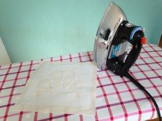 ironing the freezer paper to fabric