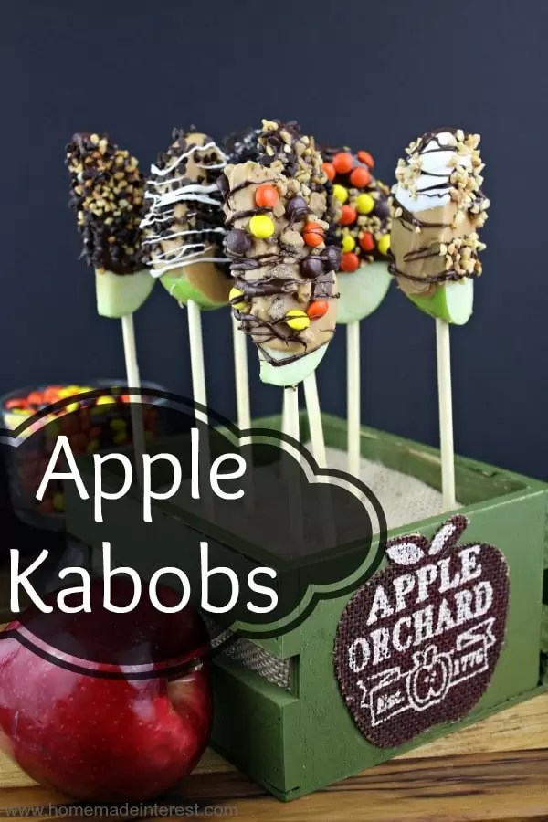 Apple Kabobs are apples dipped in chocolate or caramel and then rolled in nuts and candy toppings. A perfecttreat for a holiday party or classroom snack.