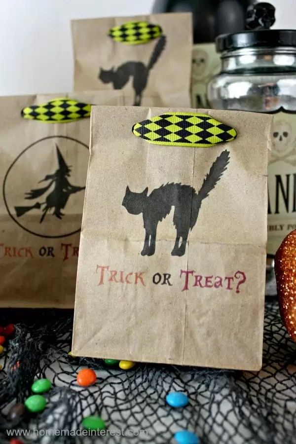 Print on brown paper bags with your home printer to make these cute Halloween Treat Bags. Trick or Treat printable included.