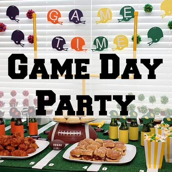 When we can't make it to the football game for tailgating we bring the party to our living room with a little homegating! We go all out with fun game day decorations and game day recipes. Table goals, snickers crescent rolls, skittles popcorn, and a table that looks like a football field, we are ready to party!