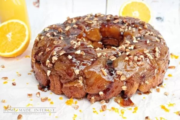 This ooey gooey monkey bread recipe is a twist on the classic. Made with cinnamon rolls this orange caramel pecan monkey bread is a perfect sweet treat..