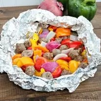 This meal is so easy to make and it is full of flavor! Italian sausage, peppers, and onions grilled in a foil packet. I can't wait to make it again!