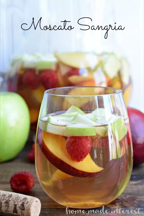 This light Moscato Sangria is at the top of my summer drinks list! Made with fresh summer fruit and lightly sweet moscato wine.