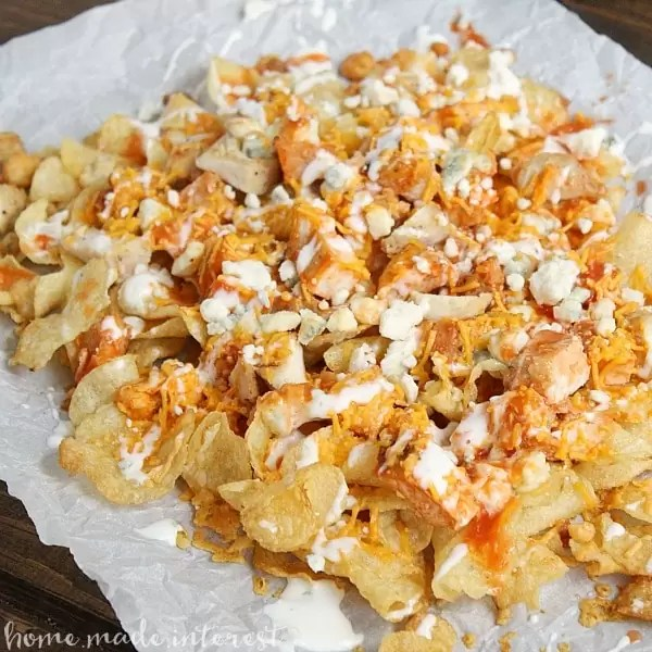 This easy buffalo chicken nacho recipe is perfect for game day and makes a simple party food that your guests are going love!