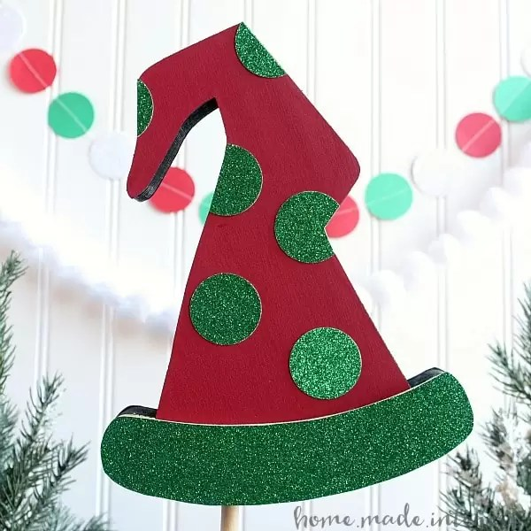 This Christmas Elf craft is a simple way to decorate your house for Christmas. You can buy the wood form and then decorate it with scrapbook paper, paint, anything you like! It is the perfect easy Christmas craft and the kids will love helping too.