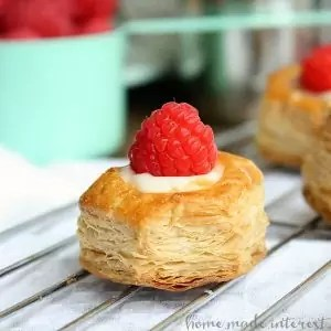 These sweet, bite size, White Chocolate Raspberry Puffs are a simple dessert recipe that is perfect for the holidays!