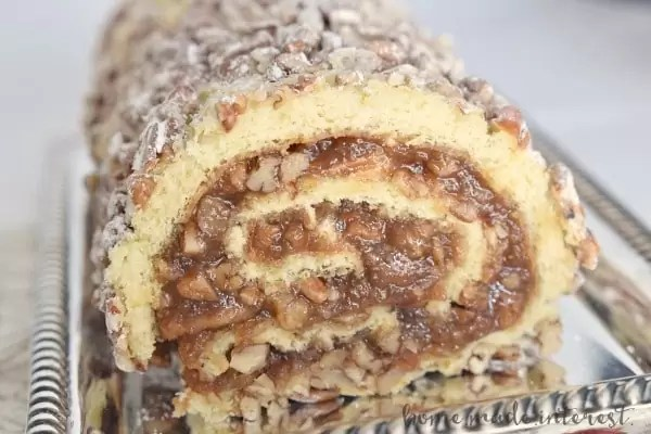 Pecan pie filling rolled into a light sponge cake make this pecan pie cake roll a perfect Thanksgiving dessert.